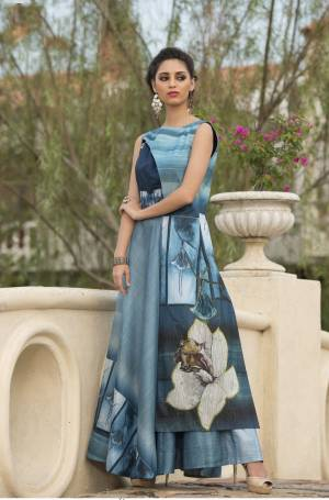Beautiful Shades In Blue Are Used In This Beautiful Readymade Gown Fabricated On Art Silk. It Is Beautified With Digital Prints All Over. Buy This Gown Now.