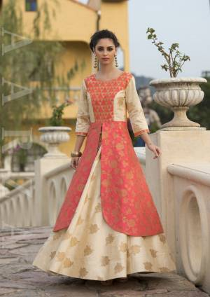 Celebrate This Festive Season Wearing This Heavy Looking Designer Gown In Orange And Cream color Fabricated On Art Silk. This Gown IS Available In All Regular Sizes, So Choose Accordingly. Buy Now.