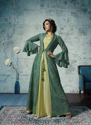 Grab This Designer Readymade Gown With Jacket In Pastel Green And Green Color. Its Is Fabricated On Maslin And Linen Satin Beautified With Prints Over The Jacket And Embroidred Neckline.