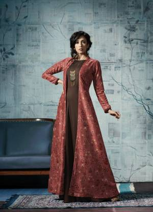 Another Designer Gown With Jacket Is Here In Brown And Red Color Fabricated On Tussar Silk And Rayon. Its Lovely Color Pallete Wirll Earn You Lots Of Compliments From Onlookers.