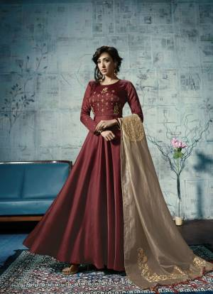 For A Rich And Royal Look, Grab This Designer Floor Length Readymade Gown In Maroon Color Fabricated On Linen Satin , It Is Paired With Beige Colored Embroidered Dupatta Which Is Fabricated On Orgenza Silk. Buy Now.