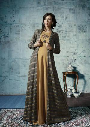 Get Ready For The Upcoming Festive Season, With This Designer Floor Length Gown In Beige And Dark Grey Color .It Is Fabricated Rayon With Ikkat Printed Jacket. Its Fabrics Are Soft Towards Skin And Easy To Carry All Day Long.