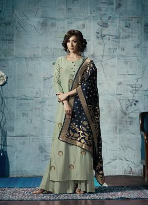 You Will Definitely Earn Lots Of Compliments Wearing This Designer Dress In Pastel Green Color Fabricated On Maslin Silk. Also This Readymade Suit Is Paired With Contrasting Navy Blue Colored Viscose Jacquard Dupatta Adding More Beauty To The Dress, You Can Pair It Up With Same Pastel Green Plazzo Or Leggings.