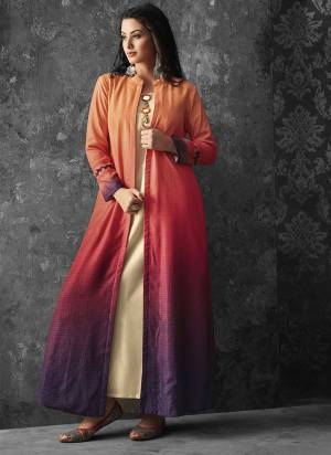This Festive Season Look The Most Unique Of All Wearing This Designer Readymade Kurti With Jacket, Its Cream Colored Kurti Paired With Orange And Purple Colored Jacket. It Is Fabricated On Muslin Paired With Shaded Linen Fabricated Jacket.
