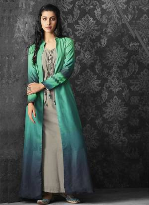 New And Unique Color Pallete Is Here With This Designer Readymade Dress In Grey Colored Inner Paired With Green And Blue Colored Jacket. Its Inner Is Fabricated On Muslin Paired With Linen Jacket.