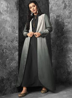 Flaunt Your Rich And Elegant Taste With This Subtle Color Pallete In Black Colored Inner Paired With Grey Colored Jacket. This Readymade Dress Is Available In All Regular Sizes. Buy Now.