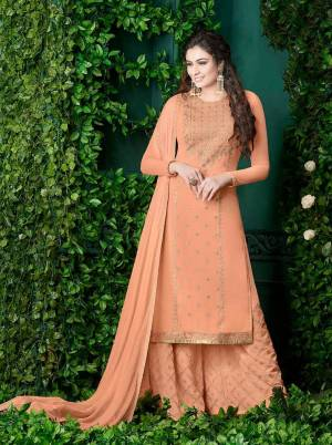 A Must Have Shade In Womens Wardrobe Is Here With This Designer Plazzo Suit In Peach Color Paired With Peach Colored Bottom And Dupatta. Its Top And Bottom Are Georgette Fabricated Paired With Chiffon Dupatta Beautified with Heavy Embroidery .