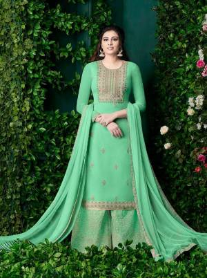 Grab This Beautiful Designer Plazzo Suit In Light Green Color Paired With Light Green Colored Dupatta. Its Heavy Embroidered Top And Bottom Are Georgette Based Paired With Chiffon Dupatta.