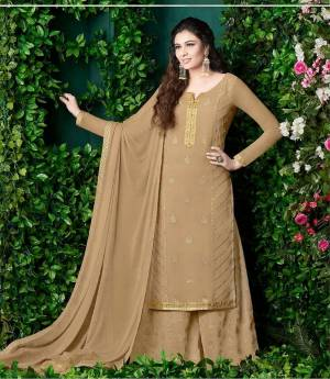 Flaunt Your Rich And Elegant Taste Wearing This Designer Plazzo Suit In Beige Color Paired With Beige Colored Bottom And Dupatta. This Rich Color And Georgette Fabric Will Earn You Lots Of Compliments From Onlookers. Buy Now.