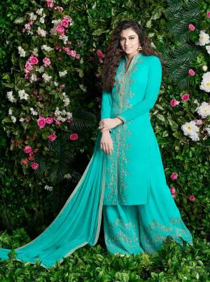 Celebrate This Festive Season With And Comfort With This Plazzo Suit In Turquoise Blue Color Paired With Turquoise Blue Colored Dupatta. Its Top And Bottom Are Georgette Based Paired With Chiffon Dupatta. It Is Beautified With Jari Embroidery And Stone Work.