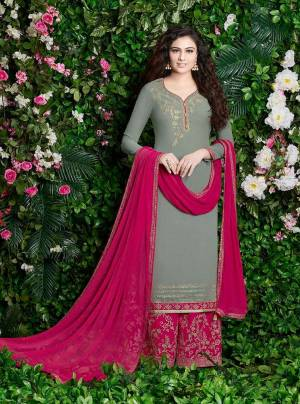 Elegant And Rich Looking Designer Plazzo Suit Is Here In Grey Colored Top Paired With Contrasting Rani Pink Colored Bottom And Dupatta. Its Top And Bottom Are Georgette Based Paired With Chiffon Dupatta. Buy This Suit Now.