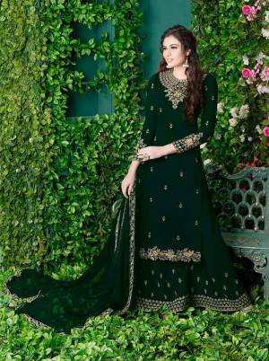 Dark Colors Always Gives A Fresh And Sleek Look To Your Personality, So Grab This Designer Plazzo Suit In Forest Green Color Paired With Forest Green Colored Bottom And Dupatta. Its Top and Bottom Are Georgette Based Paired With Chiffon Dupatta. Buy Now.