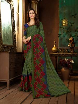 Buy This Lovely Saree In Green Color Paired With Contrasting Royal Blue Colored Blouse. This Saree Is Fabricated On Georgette Paired With Art Silk Fabricated Blouse. It Is Beautified With Prints And Thread Work.