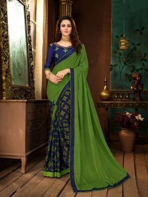 Add This Pretty Saree To Your Wardrobe In Green And Blue Color Paired With Royal Blue Colored Blouse. This Saree IS Georgette Based Paired With Art Silk Fabricated Blouse. Buy Now.