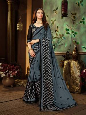 Flanut Your Rich And Elegant Taste Wearing This Designer Saree In Dark Grey Color Paired With Black Colored Blouse. This Saree Is Fabricated On Georgette Paired With Art Silk Fabricated Blouse. Buy This Saree Now.
