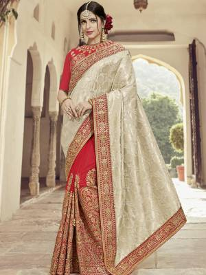 All the Fashionable women will surely like to step out in style wearing this Cream and red color silk jacquard and two tone silk saree. this gorgeous saree featuring a beautiful mix of designs. look gorgeous at an upcoming any occasion wearing the saree. Its attractive color and heavy designer embroidered saree, moti design, also heavy designer blouse, half half design saree, beautiful floral design all over work over the attire & contrast hemline adds to the look. Comes along with a contrast unstitched blouse.