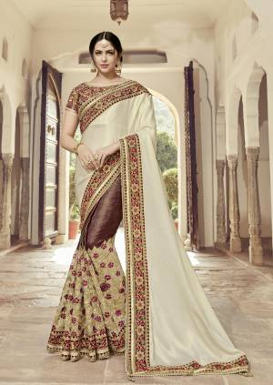 Flaunt a new ethnic look wearing this Cream And maroon color satin georgette with glitter and lycra saree. this party wear saree won't fail to impress everyone around you. this gorgeous saree featuring a beautiful mix of designs. Its attractive color and heavy designer embroidered saree, moti design, also heavy designer blouse, cut paste design saree, beautiful floral design all over work over the attire & contrast hemline adds to the look. Comes along with a contrast unstitched blouse.