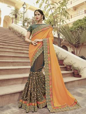 you Look striking and stunning after wearing this orange and brown color two tone satin georgette and two tone silk fabrics saree. look gorgeous at an upcoming any occasion wearing the saree. this party wear saree won't fail to impress everyone around you. Its attractive color and heavy designer embroidered saree, moti design, also heavy designer blouse, cut paste design saree, beautiful floral design all over work over the attire & contrast hemline adds to the look. Comes along with a contrast unstitched blouse.