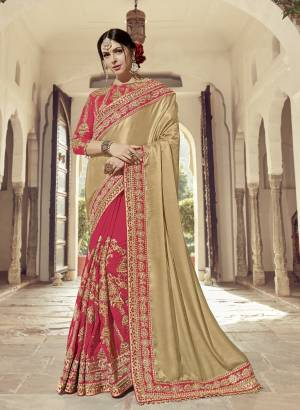 You can this amazing saree and look pretty like never before. wearing this Golden & DArk Pink  Color two tone satin glitter and two tone silk fabrics saree. this gorgeous saree featuring a beautiful mix of designs. look gorgeous at an upcoming any occasion wearing the saree. Its attractive color and heavy designer embroidered saree, moti design, also heavy designer blouse, half half design saree, beautiful floral design all over work over the attire & contrast hemline adds to the look. Comes along with a contrast unstitched blouse.