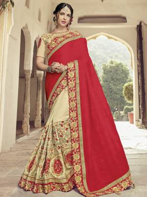Drape this red and Cream color two tone silk fabrics saree. this gorgeous saree featuring a beautiful mix of designs. look gorgeous at an upcoming any occasion wearing the saree. Its attractive color and heavy designer embroidered saree, moti design, also heavy designer blouse, cut paste design saree, beautiful floral design all over work over the attire & contrast hemline adds to the look. Comes along with a contrast unstitched blouse.