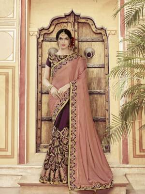 Classy, sensuous and versatile are the perfect words to describe this Dusty Pink And Wine  color two tone satin saree. Ideal for party, festive & social gatherings. this gorgeous saree featuring a beautiful mix of designs. Its attractive color and heavy designer embroidered saree, moti design, also heavy designer blouse, half half design saree, beautiful floral design all over work over the attire & contrast hemline adds to the look. Comes along with a contrast unstitched blouse.