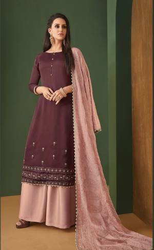 Look Pretty In This Beautiful Designer Suit In Wine Colored Top Paired With Contrasting Dusty Pink Colored Plazzo And Dupatta. Its Top Is Satin Georgette Fabricated Paired With Georgette Plazzo And Heavy Embroidered Georgette Dupatta. Buy Now.