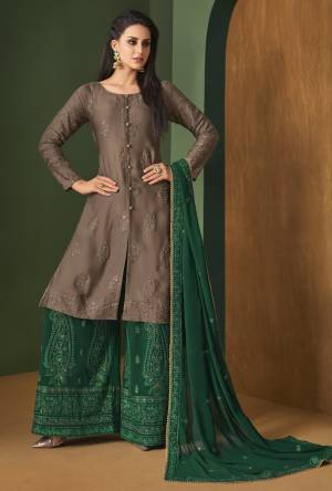 New Color Pallete Is Here With This Designer Straight Suit In Brown Colored Top Paired With Contrasting Dark Green Colored Bottom And Dupatta. Its Top Is Fabricated On Satin Georgette Paired With Georgette Bottom And Dupatta. It Has Tone To Tone Embroidery All Over It Which Gives A Subtle Look.