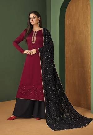 Rich And Elegant Looking Designer Suit Is Here In Maroon Colored Top Paired With black Colored Bottom And Dupatta. Its Top IS Fabricated On Satin Georgette Paired With Georgette Bottom And Dupatta.