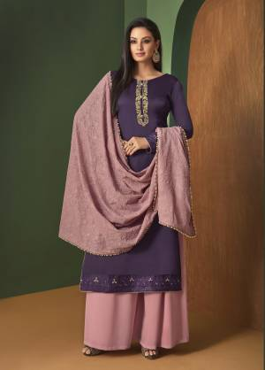 Here Is A Beautiful Designer Suit In Purple Colored Top Paired With Contrasting Baby Pink Colored Bottom And dupatta. Its Top Is Satin Georgette Fabricated Paired With Georgette Bottom And Dupatta. Its Lovely Color Pallet Will Earn You Lots Of Compliments From Onlookers.