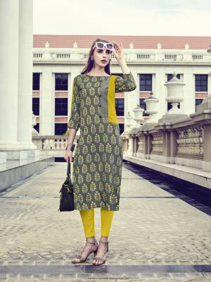 In Your College Or Your Work Place, This Readymade Grey Colored Kurti IS Suitable For All. IT IS Fabricated On Rayon Beautified With Prints All Over It. Buy Now.