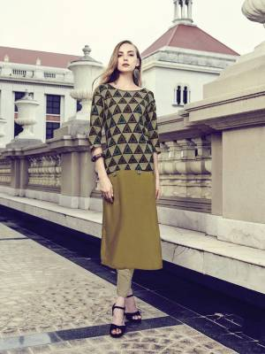 Add This Multi Colored Readymade Kurti To Your Wardrobe, It Is Fabricated On Rayon Beautified With Geometric Prints. It Is Also Available In All Regular Sizes.