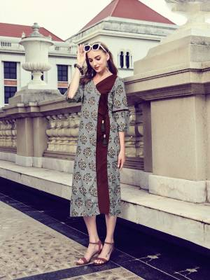 You Will Earn Lots Of Compliments Wearing This Designer Readymade Kurti In Grey And Maroon Color Fabricated On Rayon. This Is Available In All Regular Sizes. Buy Now.