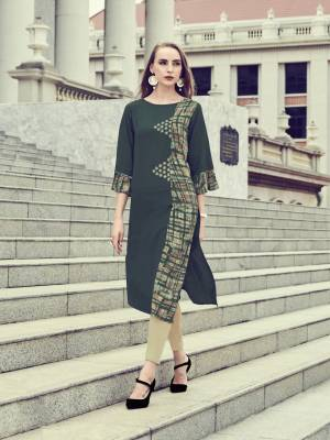 For A Patterned Look, Grab This Readymade Kurti In Dark Green Color Fabricated On Rayon. Its Fabric Ensures Superb Comfort All Day Long And Its Easy To Care For And Durable.