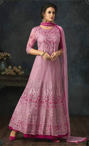 Look Pretty In This Designer Floor Length Suit In Pink Color Paired With Pink Colored Bottom And Dupatta. Its Top Is Fabricated On Net With Heavy Embroidery All Over Paired With Santoon Bottom And Chiffon Dupatta.