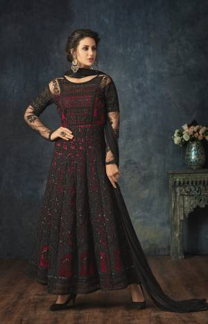 For A Bold And Beautiful Look, Grab This Designer Floor Length Suit In Black And Red Color Paired With Black Colored Bottom And Dupatta. Its Top Is Net Based Paired With Santoon Bottom And Chiffon Dupatta. Buy Now.