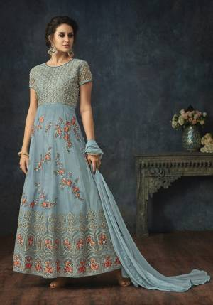 Here A Very Pretty Shade With This Designer Floor Length Suit In Light Blue Color Paired With Light Blue Colored Bottom And Dupatta. Its Top Is Net Based Paired With Santoon Bottom And Chiffon Dupatta.