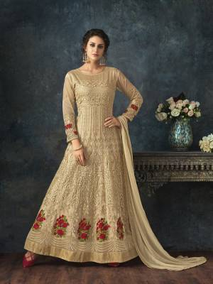 Simple And Elegant looking Designer Floor Length Suit Is Here In Beige Color Paired With Beige Colored Bottom And Dupatta. Its Top Is Net Based Paired With Santoon Bottom And Chiffon Dupatta. Buy Now.