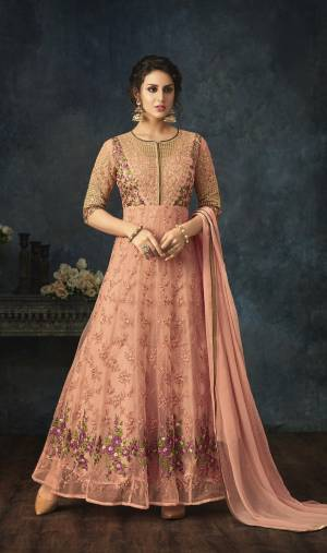 A Must Have Shade In Every Womens Wardrobe Is Here With This Designer Floor Length Suit In Peach Color Paired With Peach Colored Bottom And Dupatta. Its Top Is Fabricated On Net Paired With Santoon Bottom And Chiffon Dupatta. Buy It Now.