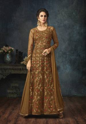 New Shade Is Here To Add Into Your Wardrobe With This Designer Floor Length Suit In Brown Color Paired With Brown Colored Bottom And Dupatta. Its Top Is Net Based With Heavy Embroidery Paired With Santoon Bottom And Chiffon Dupatta. All Its Fabric Ensures Superb Comfort All Day Long.