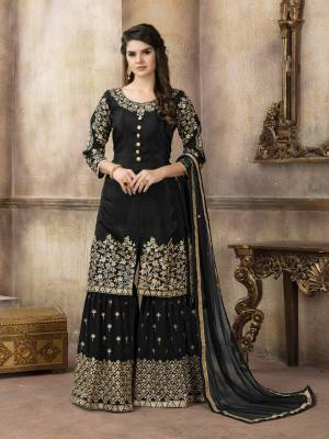 For A Bold And Beautiful Look, Grab This Designer Sharara Suit In Black Color Paired With Black Colored Bottom And Dupatta. Its Top Is Fabricated On Art Silk Paired With Georgette Bottom And Net Dupatta.