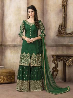 Celebrate This Festive Season with The Proper Festive Look, Wearing This Designer Sharara Suit In Dark Green Color Paired With Dark Green Colored Bottom And Dupatta. Its Top Is Silk Based Paired With Georgette Bottom And Net Dupatta.