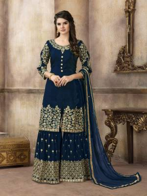 Enhance your Personality Wearing This Designer Sharara Suit In Navy Blue Color Paired With Navy Blue Colored Bottom And Dupatta. Its Top Is Silk based paired With Georgette Bottom And Net Dupatta. All Its Fabric Ensures Superb Comfort All Day Long.