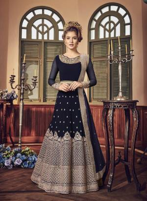 A Must Have Shade In Dark Is Here With This Heavy Designer Floor Length Suit In Navy Blue Color Paired With Navy Blue Colored Bottom And Dupatta. Its Long Heavy Top Is Georgette Based Paired With Santoon Bottom And Chiffon Dupatta. It Has Heavy Jari Embroidery Giving A Rich And Elegant Look To The Suit.