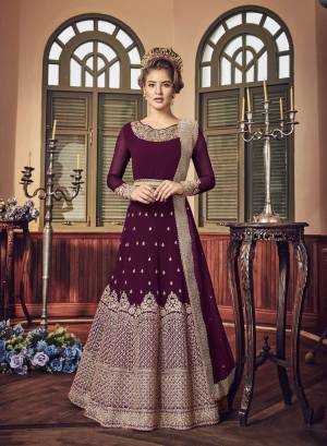 A Must Have Shade In Dark Is Here With This Heavy Designer Floor Length Suit In Magenta Pink Color Paired With Magenta Pink Colored Bottom And Dupatta. Its Long Heavy Top Is Georgette Based Paired With Santoon Bottom And Chiffon Dupatta. It Has Heavy Jari Embroidery Giving A Rich And Elegant Look To The Suit.
