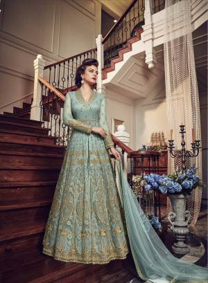 Very Pretty Looking Designer Indo-Western Suit Is Here In Light Blue Color Paired With Light Blue Colored Pant and Lehenga With Light Blue Dupatta. Its Top And Dupatta Are Net Fabricated Paired With Art Silk Pant And Lehenga. Buy This Designer Piece Now And Wear As Per The Occasion Pairing It With Pants Or Lehenga.