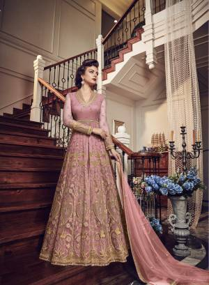 Very Pretty Looking Designer Indo-Western Suit Is Here In Blush Pink Color Paired With Blush Pink Colored Pant and Lehenga With Blush Pink Dupatta. Its Top And Dupatta Are Net Fabricated Paired With Art Silk Pant And Lehenga. Buy This Designer Piece Now And Wear As Per The Occasion Pairing It With Pants Or Lehenga.