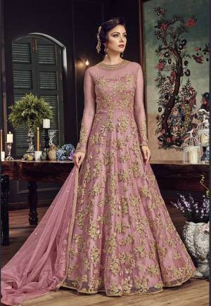 Look The Most Prettiest Of All Wearing This Heavy Designer Floor Length Suit In Pink Color Paired With Pink Colored Bottom And Dupatta. Its Top And Dupatta Are Net Fabricated Paired With Santoon Bottom. Buy Now.
