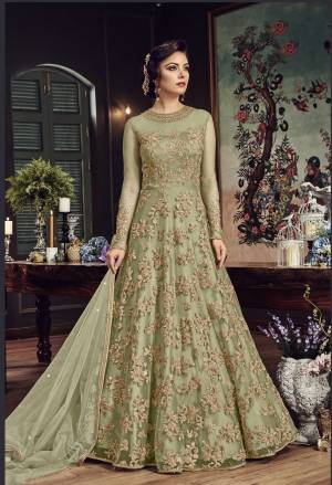 Look The Most Prettiest Of All Wearing This Heavy Designer Floor Length Suit In Mint Green Color Paired With Mint Green Colored Bottom And Dupatta. Its Top And Dupatta Are Net Fabricated Paired With Santoon Bottom. Buy Now.