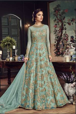 Look The Most Prettiest Of All Wearing This Heavy Designer Floor Length Suit In Aqua Blue Color Paired With Aqua Blue Colored Bottom And Dupatta. Its Top And Dupatta Are Net Fabricated Paired With Santoon Bottom. Buy Now.