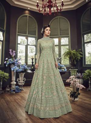 Add This Beautiful Heavy Designer Floor Length Suit In Pastel Green Color Paired With Pastel Green Colored Bottom And dupatta. Its Top And Dupatta Are Net Fabricated Paired With Art Silk Bottom. Also Its Top Is Beautified With Heavy Embroidery All Over.